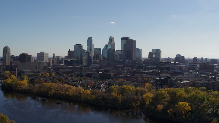 5.7K stock footage aerial video reverse view of city skyline, reveal Mississippi River, Downtown Minneapolis, Minnesota Aerial Stock Footage | DX0001_002453