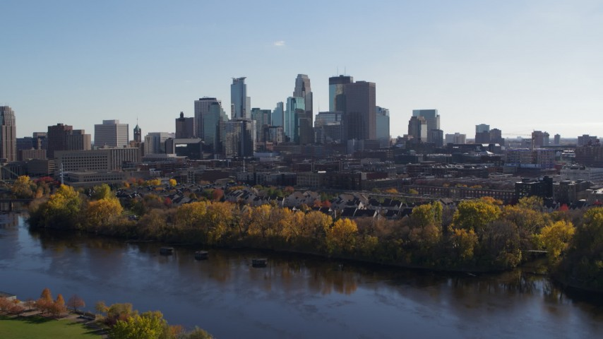 5.7K stock footage aerial video approach and flyby the city skyline, seen from Mississippi River, Downtown Minneapolis, Minnesota Aerial Stock Footage | DX0001_002454
