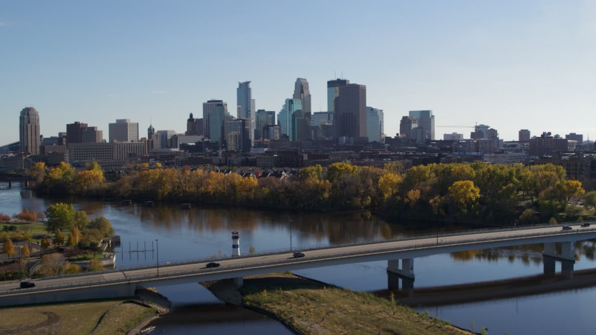 5.7K stock footage aerial video wide view of the city skyline, seen from bridge spanning Mississippi River, Downtown Minneapolis, Minnesota Aerial Stock Footage | DX0001_002456
