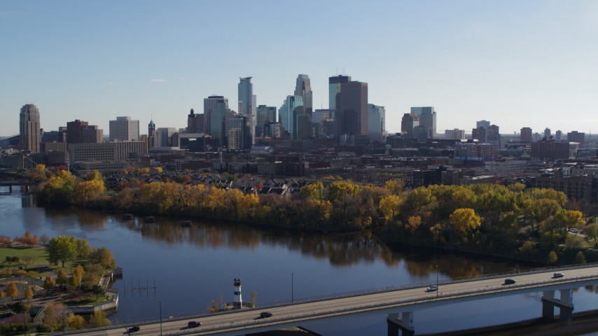 5.7K stock footage aerial video wide view of the city skyline, seen from bridge spanning the river, Downtown Minneapolis, Minnesota Aerial Stock Footage | DX0001_002457
