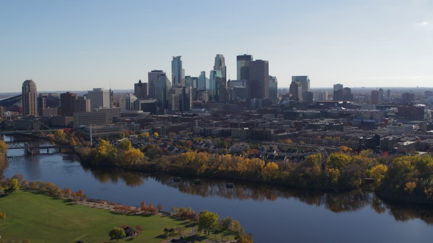 5.7K stock footage aerial video wide view of the city skyline on the other side of the river, Downtown Minneapolis, Minnesota Aerial Stock Footage | DX0001_002459