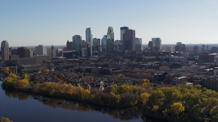 5.7K stock footage aerial video wide view of the city's skyline on the other side of the river, Downtown Minneapolis, Minnesota Aerial Stock Footage | DX0001_002460