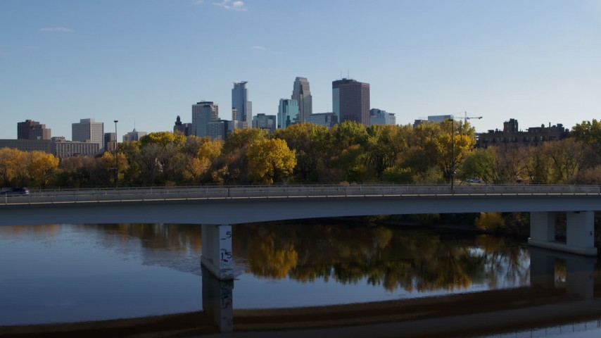 5.7K stock footage aerial video approach and fly over bridge to focus on skyline of Downtown Minneapolis, Minnesota Aerial Stock Footage | DX0001_002461