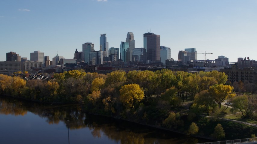 5.7K stock footage aerial video flying by Mississippi River with view of skyline of Downtown Minneapolis, Minnesota Aerial Stock Footage | DX0001_002462
