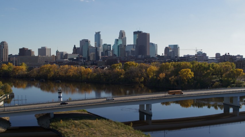 5.7K stock footage aerial video flyby bridge over the river with a view of the skyline of Downtown Minneapolis, Minnesota Aerial Stock Footage | DX0001_002463