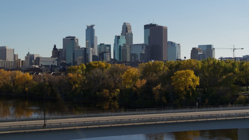 5.7K stock footage aerial video fly over bridge spanning river and focus on skyline of Downtown Minneapolis, Minnesota Aerial Stock Footage | DX0001_002466
