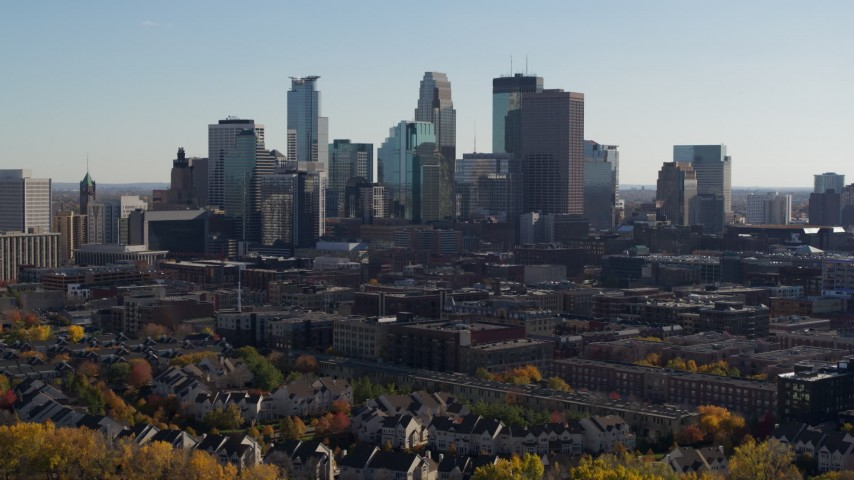 5.7K stock footage aerial video focus on city skyline while flying over river, Downtown Minneapolis, Minnesota Aerial Stock Footage | DX0001_002467