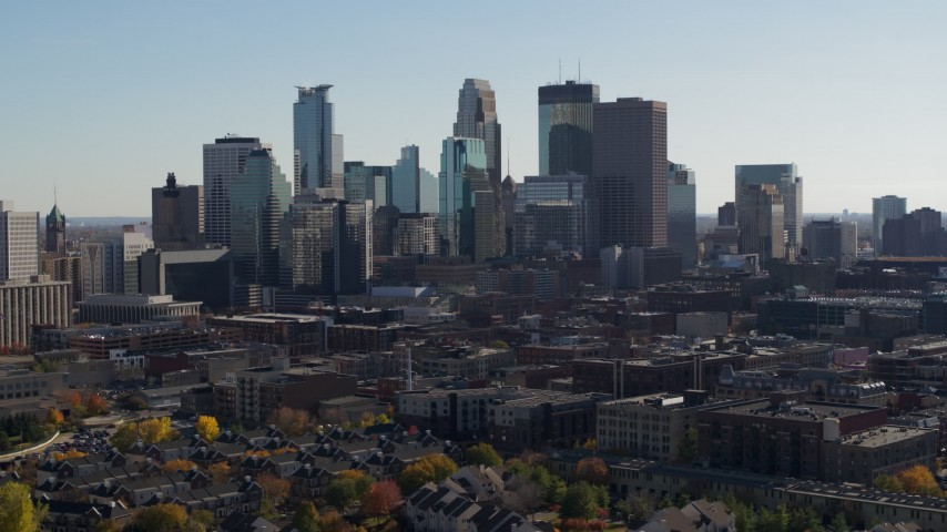 5.7K stock footage aerial video focus on skyscrapers while flying by city skyline, Downtown Minneapolis, Minnesota Aerial Stock Footage | DX0001_002469