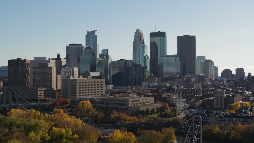 5.7K stock footage aerial video focus on skyscrapers while ascending by the city skyline, Downtown Minneapolis, Minnesota Aerial Stock Footage | DX0001_002472