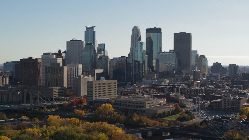 5.7K stock footage aerial video focus on skyscrapers while descending by the city skyline, Downtown Minneapolis, Minnesota Aerial Stock Footage | DX0001_002473