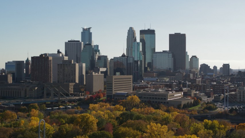 5.7K stock footage aerial video focus on skyscrapers while passing by the city skyline, Downtown Minneapolis, Minnesota Aerial Stock Footage | DX0001_002474