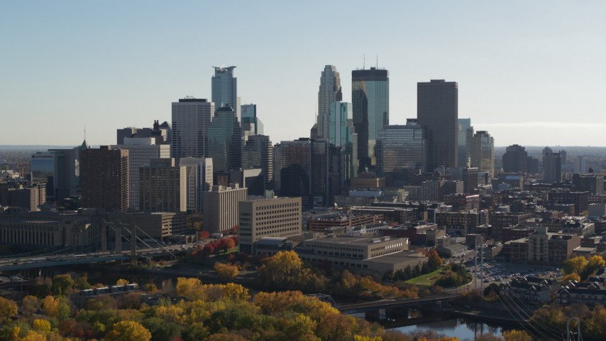 5.7K stock footage aerial video focus on tall skyscrapers while flying by the city skyline, Downtown Minneapolis, Minnesota Aerial Stock Footage | DX0001_002475