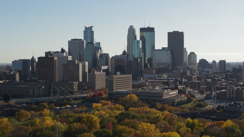 5.7K stock footage aerial video focus on tall skyscrapers while passing by the city skyline, Downtown Minneapolis, Minnesota Aerial Stock Footage | DX0001_002476
