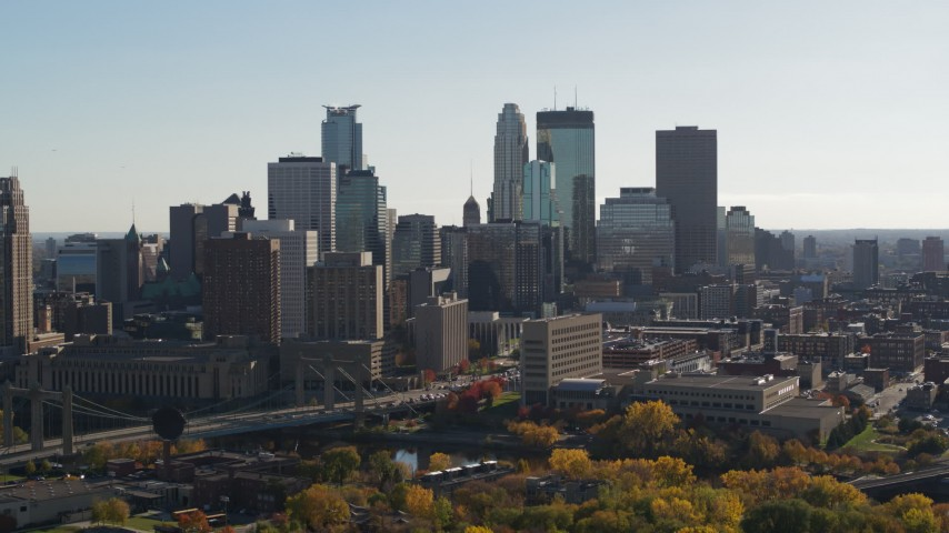5.7K aerial video focus on tall skyscrapers during ascent to stationary view of the city skyline, Downtown Minneapolis, Minnesota Aerial Stock Footage | DX0001_002479