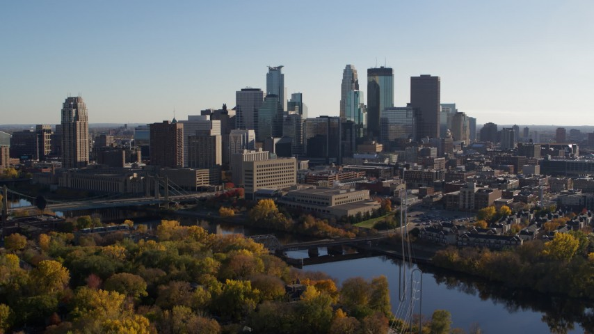 5.7K stock footage aerial video of flying by fall trees and the city skyline, ascend over the river, Downtown Minneapolis, Minnesota Aerial Stock Footage | DX0001_002490