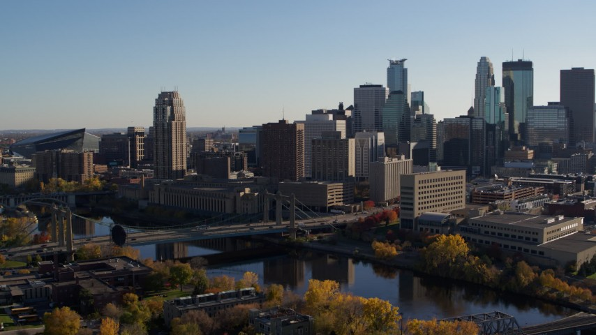 5.7K stock footage aerial video of approaching bridge spanning the river and the city skyline, Downtown Minneapolis, Minnesota Aerial Stock Footage | DX0001_002492