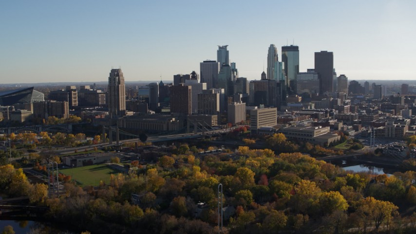 5.7K stock footage aerial video flyby park with view of city skyline across the Mississippi River, Downtown Minneapolis, Minnesota Aerial Stock Footage | DX0001_002499