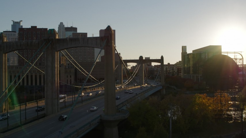 5.7K stock footage aerial video ascend from Hennepin Avenue Bridge at sunset in Downtown Minneapolis, Minnesota Aerial Stock Footage | DX0001_002502