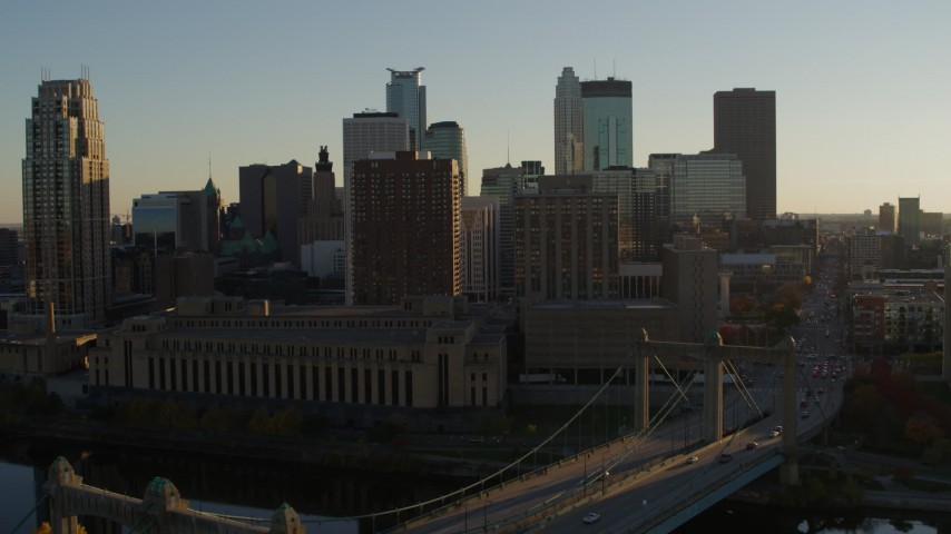 5.7K stock footage aerial video fly away from Hennepin Avenue Bridge and apartment buildings at sunset in Downtown Minneapolis, Minnesota Aerial Stock Footage | DX0001_002503