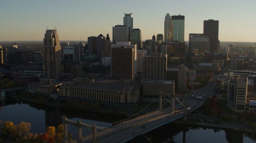 5.7K stock footage aerial video fly by Hennepin Avenue Bridge and apartment buildings at sunset in Downtown Minneapolis, Minnesota Aerial Stock Footage | DX0001_002504