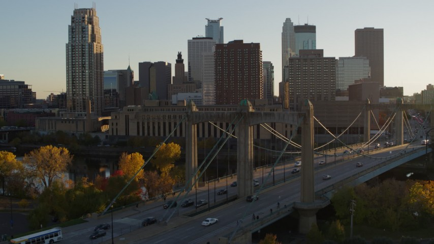5.7K stock footage aerial video approach light traffic on Hennepin Avenue Bridge at sunset in Downtown Minneapolis, Minnesota Aerial Stock Footage | DX0001_002506