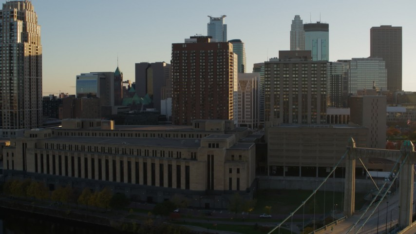 5.7K stock footage aerial video flyby Hennepin Avenue Bridge, post office and apartment buildings at sunset, Downtown Minneapolis, Minnesota Aerial Stock Footage   DX0001_002507