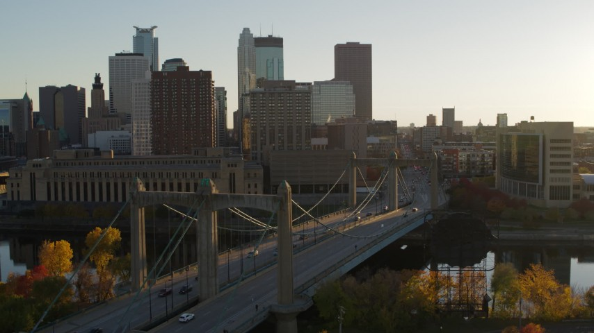 5.7K stock footage aerial video flyby Hennepin Avenue Bridge at sunset, with view of Downtown Minneapolis, Minnesota Aerial Stock Footage | DX0001_002510