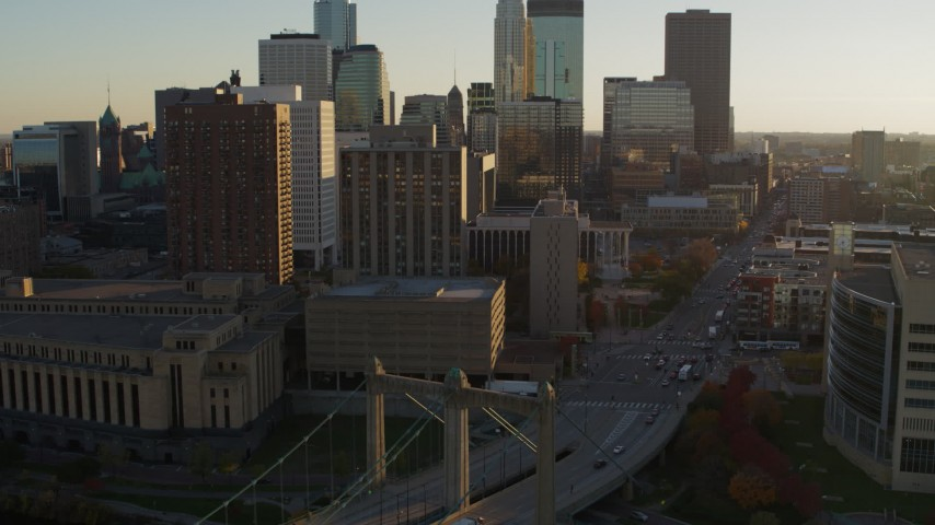 5.7K stock footage aerial video ascend near Hennepin Avenue Bridge at sunset near apartment and USPS buildings, Downtown Minneapolis, Minnesota Aerial Stock Footage | DX0001_002512