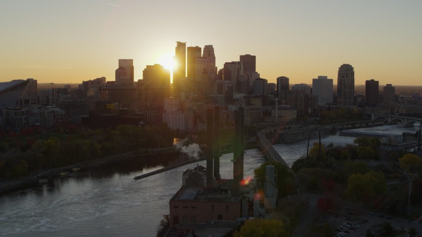 5.7K stock footage aerial video flyby riverfront power plant at sunset for view of city skyline, Downtown Minneapolis, Minnesota Aerial Stock Footage | DX0001_002527