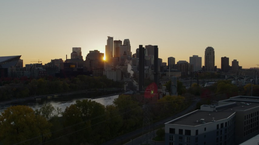 5.7K stock footage aerial video of city skyline while flying over power plant and river at sunset, Downtown Minneapolis, Minnesota Aerial Stock Footage | DX0001_002530