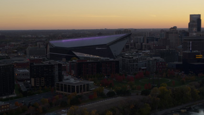 5.7K stock footage aerial video of flying by US Bank Stadium at sunset, Downtown Minneapolis, Minnesota Aerial Stock Footage | DX0001_002544