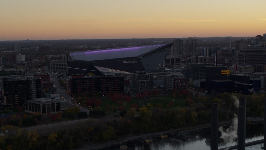 5.7K stock footage aerial video of passing by US Bank Stadium at sunset, Downtown Minneapolis, Minnesota Aerial Stock Footage | DX0001_002545