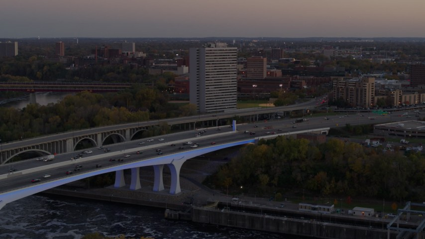 5.7K stock footage aerial video slow approach to a condo complex beside a bridge at sunset, Minneapolis, Minnesota Aerial Stock Footage | DX0001_002551
