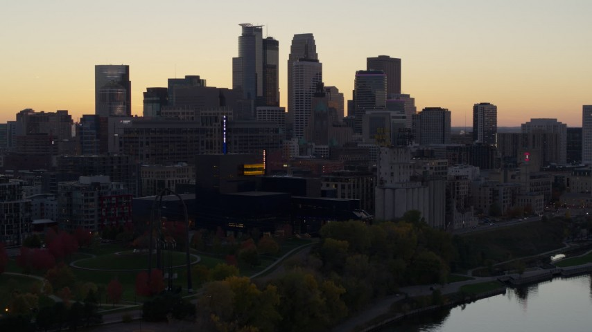 5.7K stock footage aerial video of the city's skyline seen from the river at sunset, Downtown Minneapolis, Minnesota Aerial Stock Footage | DX0001_002553