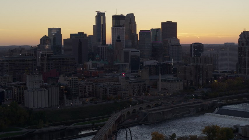 5.7K stock footage aerial video of the city's skyline seen from the over side of the river at sunset, Downtown Minneapolis, Minnesota Aerial Stock Footage | DX0001_002554