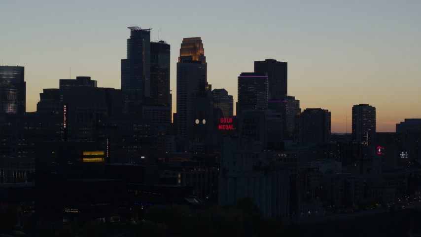 5.7K stock footage aerial video slowly flying by the city skyline at twilight, Downtown Minneapolis, Minnesota Aerial Stock Footage | DX0001_002560