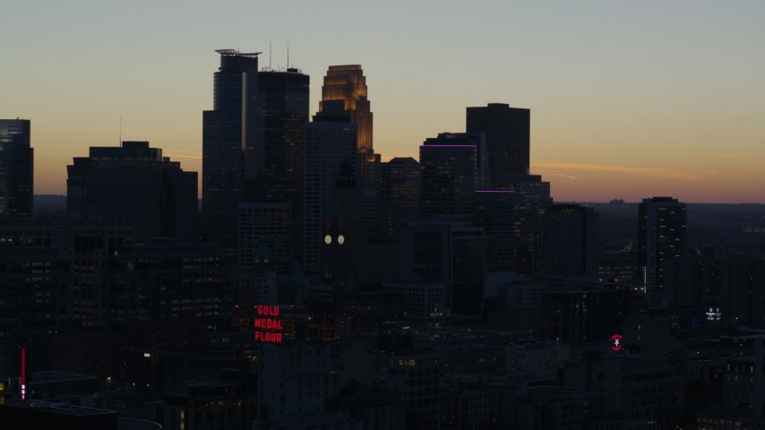 5.7K stock footage aerial video slowly passing by the city skyline at twilight, Downtown Minneapolis, Minnesota Aerial Stock Footage | DX0001_002561