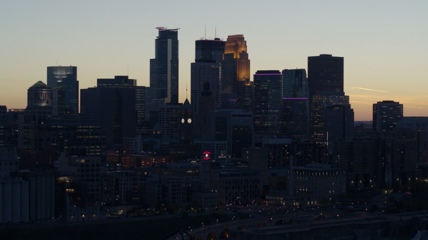 5.7K stock footage aerial video slow flyby of the city skyline at twilight, Downtown Minneapolis, Minnesota Aerial Stock Footage | DX0001_002562