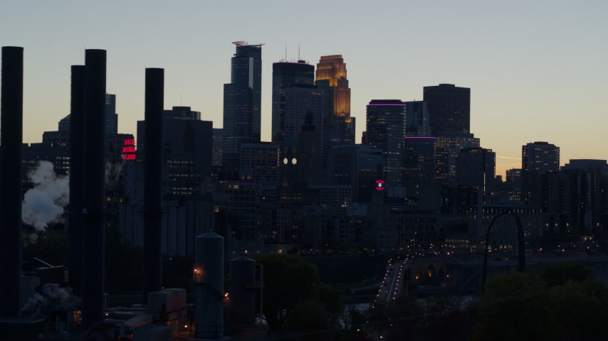 5.7K stock footage aerial video slow pass of the city skyline at twilight, reveal the power plant, Downtown Minneapolis, Minnesota Aerial Stock Footage | DX0001_002563