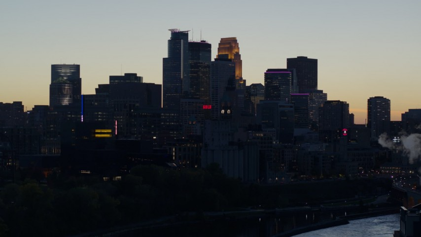 5.7K stock footage aerial video slow pass of the city skyline across the river at twilight, Downtown Minneapolis, Minnesota Aerial Stock Footage | DX0001_002564