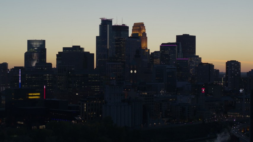 5.7K stock footage aerial video slow flyby of the city skyline across the river at twilight, Downtown Minneapolis, Minnesota Aerial Stock Footage | DX0001_002565