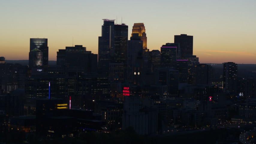 5.7K stock footage aerial video of focusing on the city skyline at twilight, Downtown Minneapolis, Minnesota Aerial Stock Footage | DX0001_002569