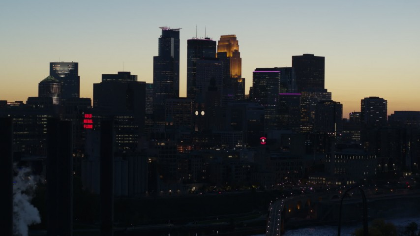 5.7K stock footage aerial video flyby the skyscrapers in the city skyline at twilight, reveal smoke stacks, Downtown Minneapolis, Minnesota Aerial Stock Footage | DX0001_002571