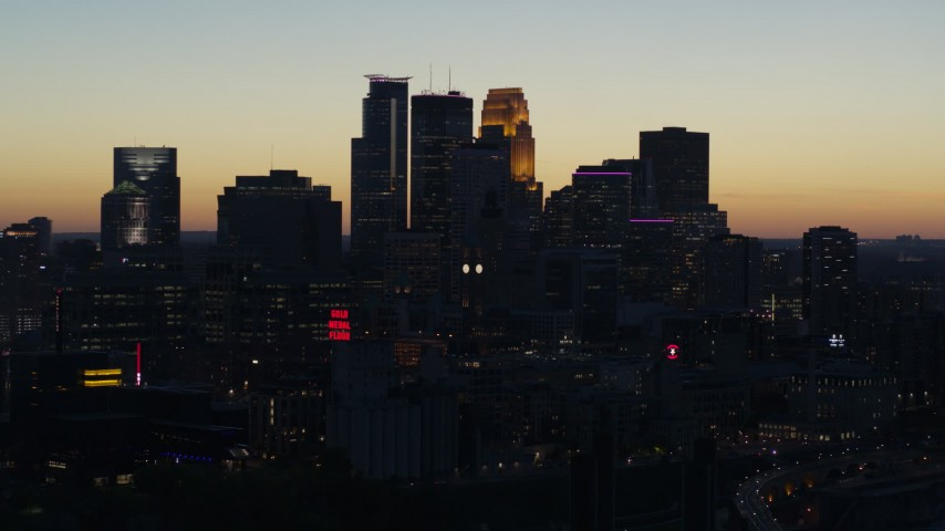 5.7K stock footage aerial video ascend by the skyscrapers in the city skyline at twilight, Downtown Minneapolis, Minnesota Aerial Stock Footage | DX0001_002572