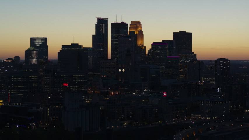 5.7K stock footage aerial video flying by the skyscrapers in the city skyline at twilight, Downtown Minneapolis, Minnesota Aerial Stock Footage | DX0001_002573