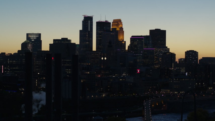 5.7K stock footage aerial video flyby the skyscrapers in the city skyline at twilight, Downtown Minneapolis, Minnesota Aerial Stock Footage | DX0001_002575