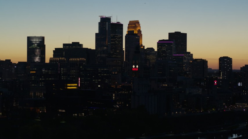 5.7K stock footage aerial video pass skyscrapers lit for night in the city skyline at twilight during descent, Downtown Minneapolis, Minnesota Aerial Stock Footage | DX0001_002578