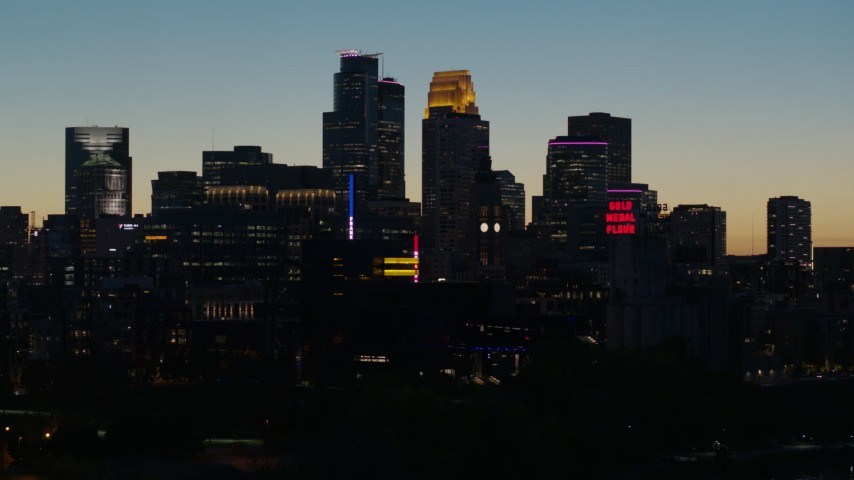 5.7K stock footage aerial video focus on the city skyline lit for the night at twilight, Downtown Minneapolis, Minnesota Aerial Stock Footage | DX0001_002586