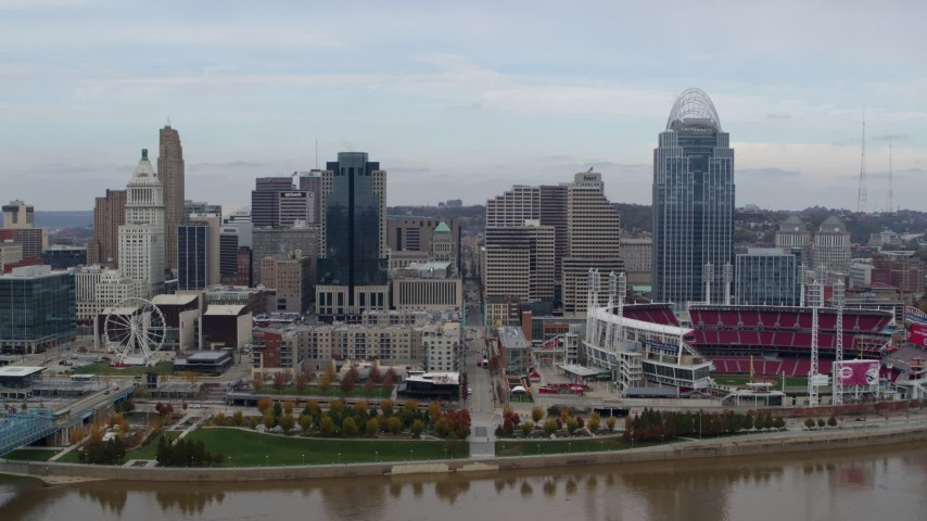 5.7K stock footage aerial video flying by city skyline and baseball stadium, seen from the river, Downtown Cincinnati, Ohio Aerial Stock Footage | DX0001_002588