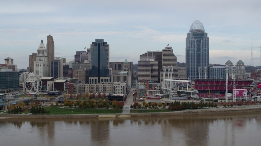 5.7K aerial video flying by city skyline and baseball stadium, seen from the river during descent, Downtown Cincinnati, Ohio Aerial Stock Footage | DX0001_002589